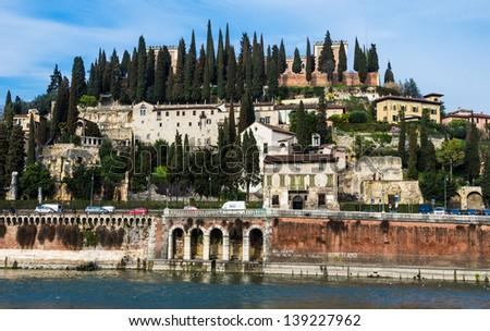 Roman Theater and San Pietro hill seen from Adige river. Verona, Italy. - stock photo