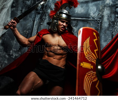 Roman warrior with muscular body fights - stock photo