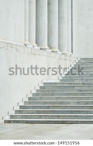 Roman white stone stair with poles at the back - stock photo