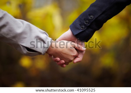 Romance - Caucasian Couple holding hands in fall