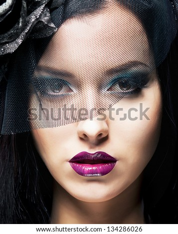 Romance. Portrait of Spectacular Styled Woman in Retro Black Veil - stock photo