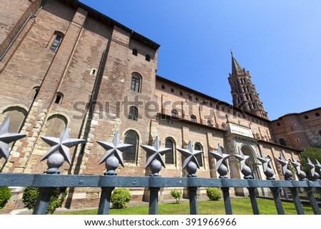 Romanesque Basilica of Saint Sernin with bell tower, Toulouse, France - stock photo