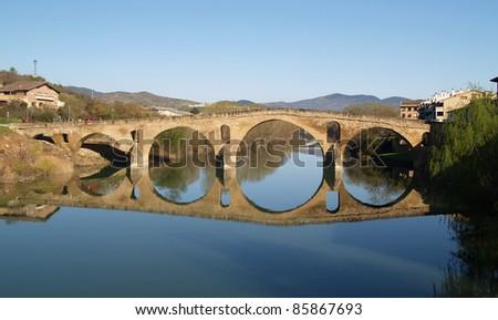 Romanesque bridge At Puente la Reina, Spain, UNESCO - the Pilgrim's Road to Santiago de Compostela - stock photo