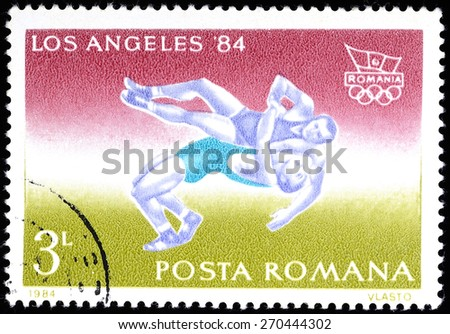 """ROMANIA -CIRCA 1984: A stamp printed in Romania from the """"Summer Olympic Games, Los Angeles 1984"""" issue shows a swimming athlete, circa 1984 - stock photo"""