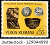 "ROMANIA - CIRCA 1976: A stamp printed in Romania, shows Ceramic fragment, bowl, coins, with inscription and name of series ""Daco-Roman Archeological Treasures"", circa 1976 - stock photo"