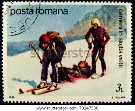 ROMANIA - CIRCA 1989: A stamp printed in Romania shows image of a skier rescuers, circa 1989