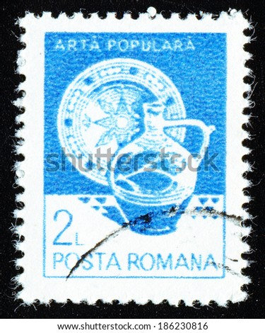 ROMANIA - CIRCA 1982: A stamp printed in Romania shows Plate and jug from Vama, circa 1982 - stock photo