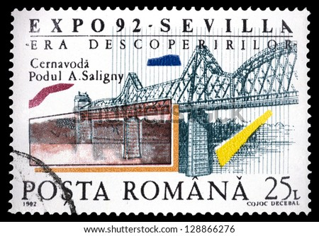 "ROMANIA - CIRCA 1992: A stamp printed in Romania shows Railroad bridge, Cernavoda, with the inscription and name of series ""World's Fair Expo 92, Seville. Era of Discovery"", circa 1992"