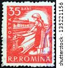 ROMANIA - CIRCA 1960: A stamp printed in Romania shows textile worker, circa 1960. - stock photo