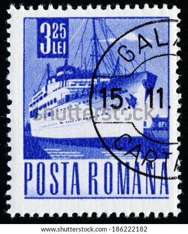 ROMANIA - CIRCA 1967: A stamp printed in Romania shows the ''Transylvania'' liner, circa 1967. - stock photo