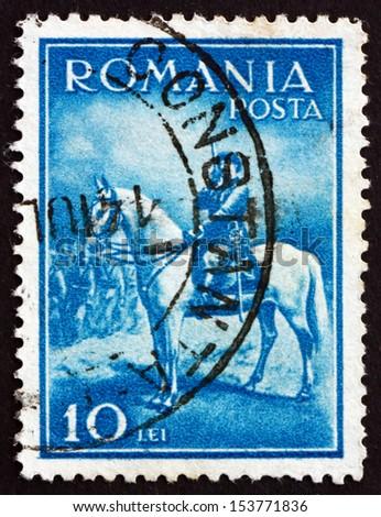 ROMANIA - CIRCA 1932: a stamp printed in the Romania shows King Carol II, King of Romania, circa 1932 - stock photo