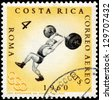 ROMANIA - CIRCA 1960: A stamp printed in the Romania shows weightlifting, Summer Olympics, Roma 60, circa 1960 - stock photo