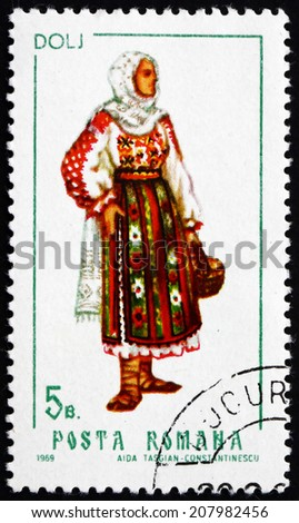 ROMANIA - CIRCA 1969: a stamp printed in the Romania shows Woman from Dolj, Traditional Regional Costume, circa 1969 - stock photo
