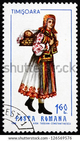 ROMANIA - CIRCA 1969: a stamp printed in the Romania shows Woman from Timisoara, Traditional Regional Costume, circa 1969 - stock photo