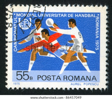ROMANIA - CIRCA 1975: stamp printed by Romania, shows Field Ball and Games Emblem, circa 1975