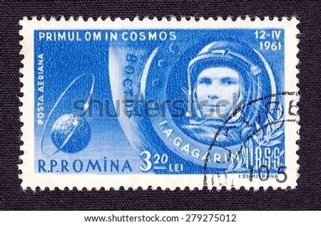 ROMANIA - CIRCA 1961: stamp printed by Romania, shows Yuri Gagarin-cosmonaut of the USSR, circa 1961 - stock photo