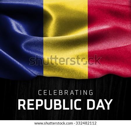 Romania flag and Celebrating Republic Day Typography on wood background - stock photo
