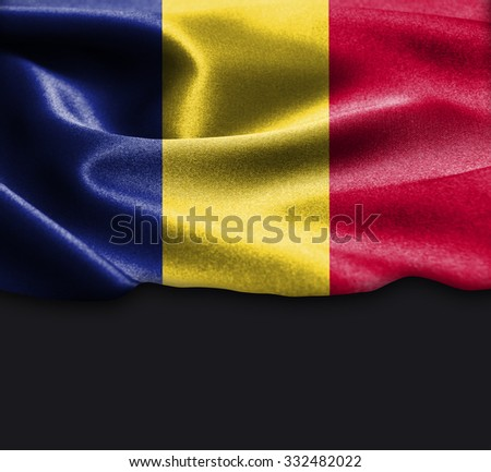 Romania flag on smooth silk texture Dark Background Space for Text - stock photo