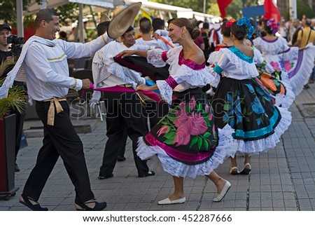 "ROMANIA, TIMISOARA - JULY 7, 2016: Dancers from Colombia in traditional costume, present at the international folk festival, ""International Festival of hearts"" organized by the City Hall Timisoara."