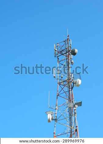 Romanian communication tower close up with antennas and parabolic for optimal signal and reception.