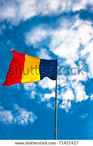 Romanian flag against blue sky - stock photo