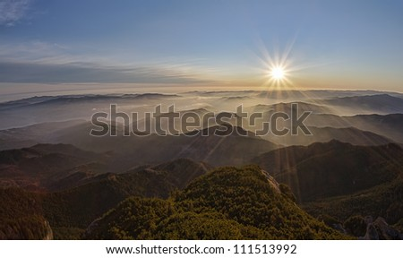 Romanian landscape in Carpathians with mystic sunset
