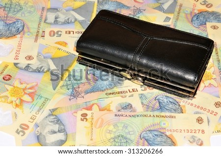 Romanian lei background with black leather wallet  - stock photo