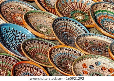 Romanian traditional ceramic in the plates form, painted with specific reasons Horezu area. - stock photo
