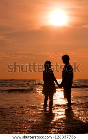 romantic and happiness scene of couples on the Beach - stock photo