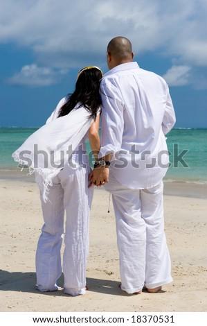 romantic asian couple at the beach - stock photo