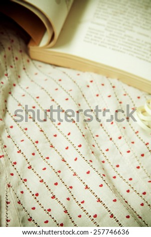 romantic background with book and fabric - stock photo