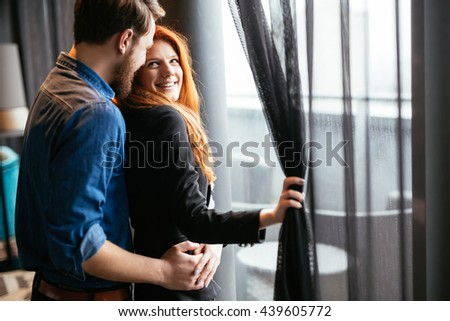 Romantic beautiful couple sharing genuine emotions and happiness