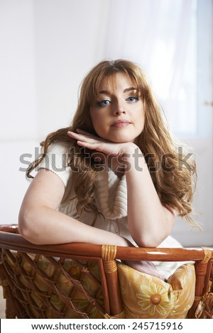 Romantic Beautiful Woman portrait in a  living room - stock photo