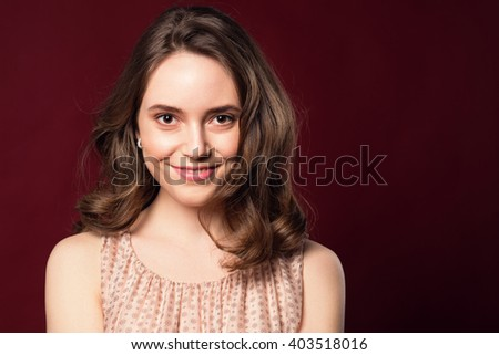 Romantic Beauty Portrait. Healthy wavy brown hair and perfect holiday make up.