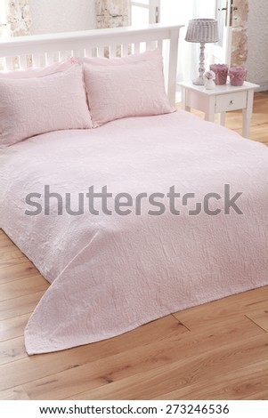 romantic bedroom decoration and sheets - stock photo