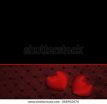 Romantic black background with hearts. - stock photo