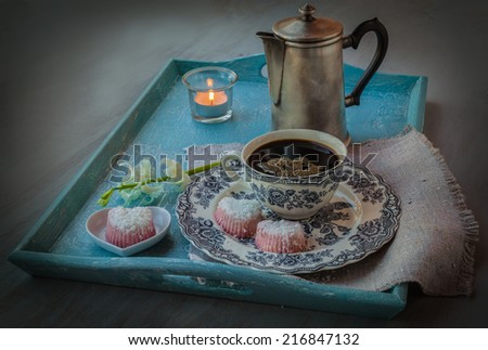 Romantic breakfast. Coffee with hyacinth and sweets in the shape of heart - stock photo