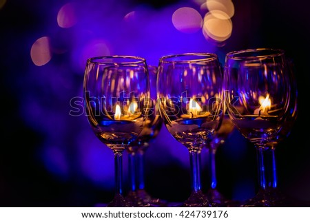 Romantic candle in  champagne glasses - stock photo