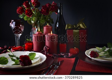 Romantic candle light Valentine Table Setting for two with red roses gift and burning candles & Romantic Candle Light Valentine Table Setting Stock Photo (Royalty ...