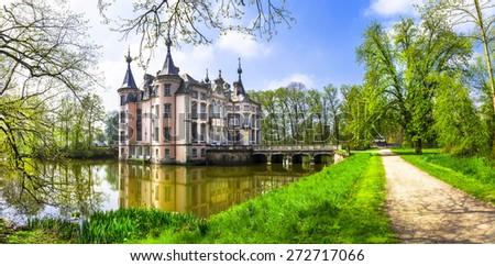 romantic castles of Europe . Poeke castle in Belgium - stock photo