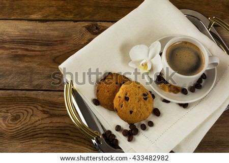 Romantic coffee served with white orchid. Coffee break. Morning cup of coffee and homemade breakfast cookie.     - stock photo
