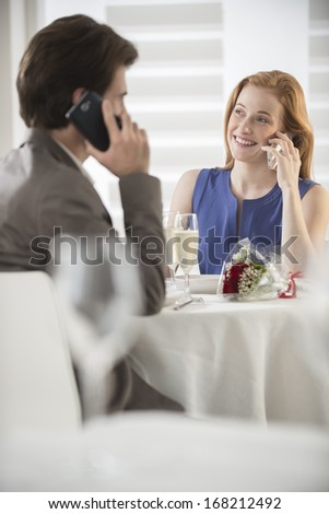 romantic couple announcing good news on the phone