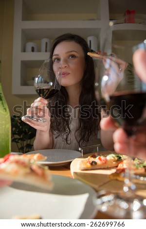 Romantic couple dating at home. Drinking red wine, eating fresh homemade pizza. Photo from the first person - stock photo