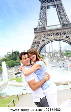 Romantic couple embracing in front of the Eiffel tower