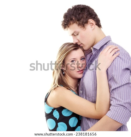 romantic couple embracing in studio isolated on white - stock photo