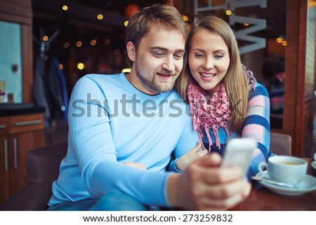 Romantic couple enjoying time in cafe