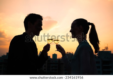 Romantic couple enjoying wine in the city - stock photo