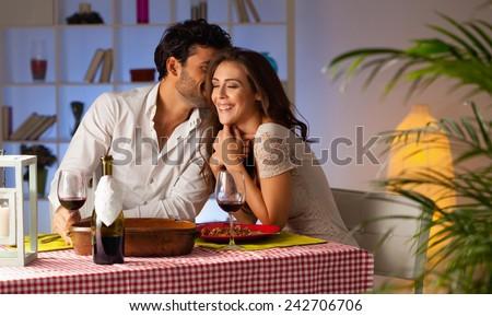 Romantic couple having dinner at home. - stock photo