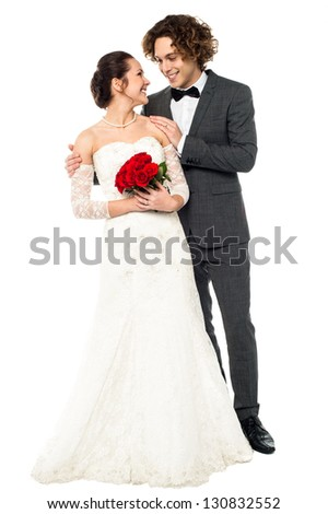 Romantic couple in bridal attire lost in each other, full length portrait. - stock photo