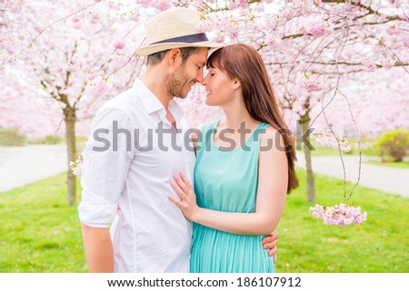 romantic couple in fairytale garden park - stock photo
